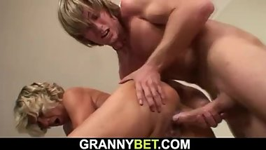 Horny young guy fucks older blonde cleaning woman from behind