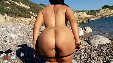 Hot Nadia Daferro getting naked on the beach